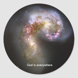 God is everywhere - Antennae galaxies sticker