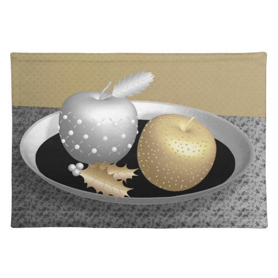 Gold and silver apples on a silver platter placemats