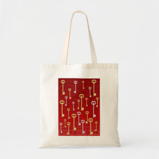 Gold and silver keys on red tote bags