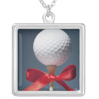 Gold ball on tee with red bow silver plated necklace