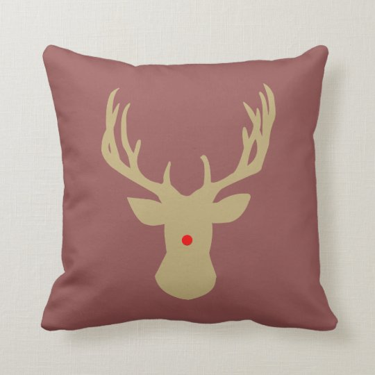 Gold Christmas deer antler pillow with a red