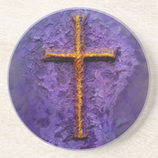 Gold cross on purple coaster