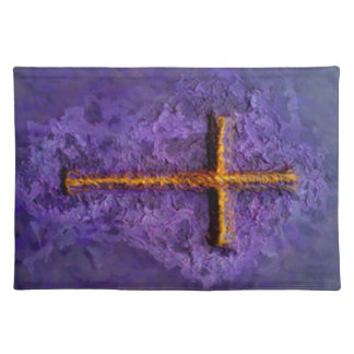Gold cross on purple placemats