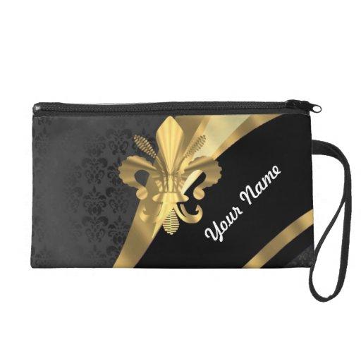 Gold fleur de lys on black wristlet clutches