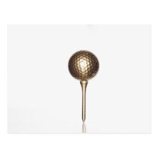 Gold golf ball and tee postcard