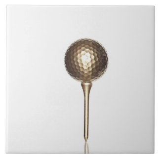 Gold golf ball and tee tile