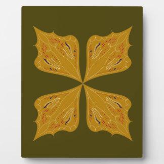 Gold mandala on olive plaque