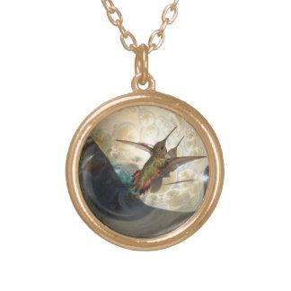 Gold metal necklace close up of a humming bird