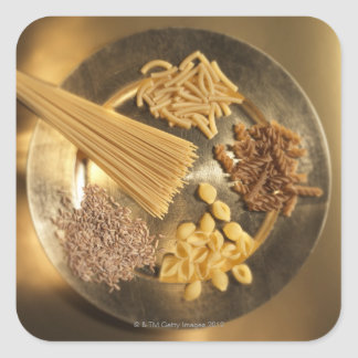 Gold Plate with pasta and grains of wheat Square Sticker