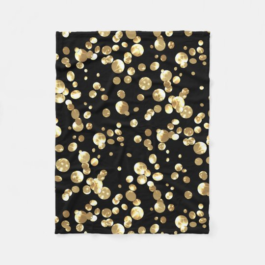 Gold polka dots on a black background .