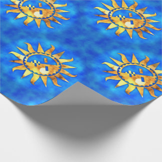 Gold suns on blue water wrapping paper