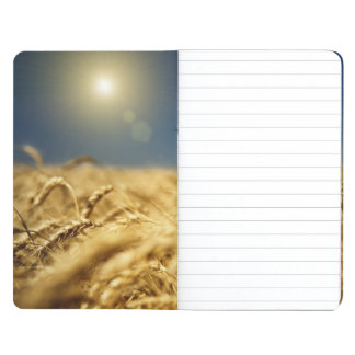 Gold wheat and blue sky with sun journal