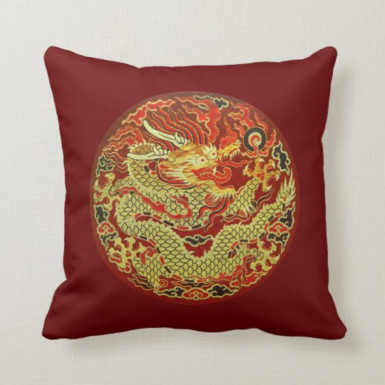 Golden asian dragon embroidered on dark red cushion
