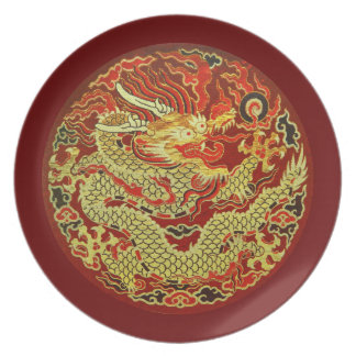 Golden asian dragon embroidered on dark red plate