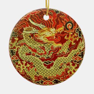 Golden asian dragon embroidered on dark red round ceramic decoration