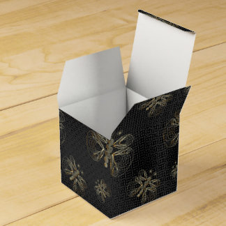 Golden butterfly on black grunge background favour box
