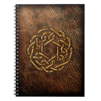 Golden celtic knot on leather notebook