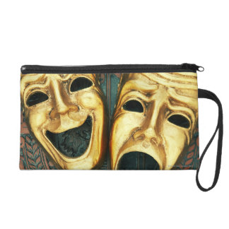 Golden comedy and tragedy masks on patterned wristlet clutch