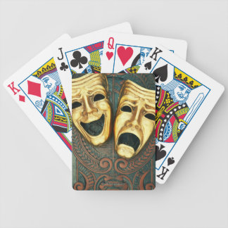 Golden comedy and tragedy masks on patterned bicycle playing cards