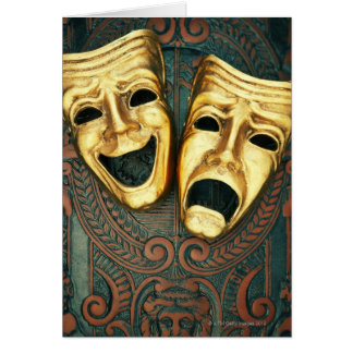 Golden comedy and tragedy masks on patterned card
