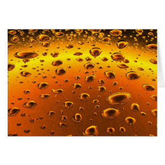 golden drops on metallic surface card