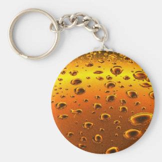 golden drops on metallic surface key ring