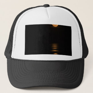 golden full moon over ocean trucker hat