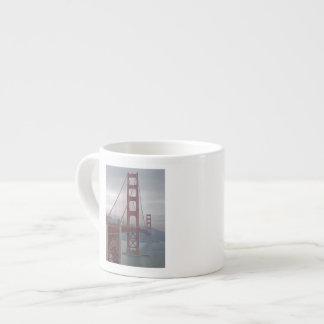 Golden gate bridge in mist. espresso cup