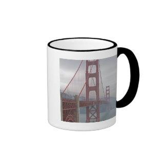 Golden gate bridge in mist. mugs