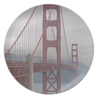 Golden gate bridge in mist. plate