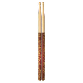 Golden leaf lace on red background drumsticks