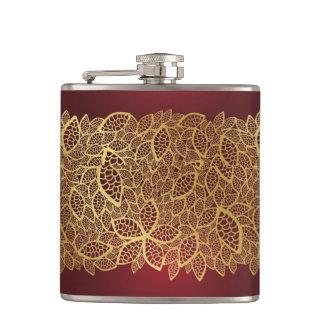 Golden leaf lace on red background hip flask