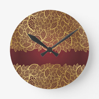 Golden leaf lace on red background round clock