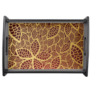 Golden leaf lace on red background serving tray
