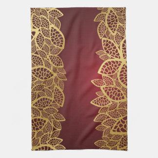 Golden leaf lace on red background tea towel