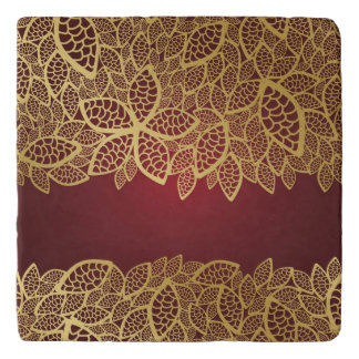 Golden leaf lace on red background trivet