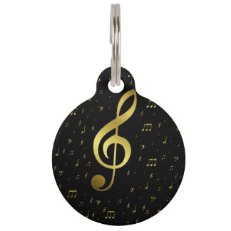 golden music notes in black pet tags