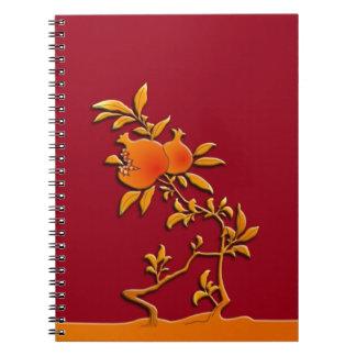 Golden pomegranate notebooks