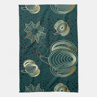 Golden pumpkin on turquoise grunge background tea towel