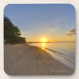 Golden Sun Ball Setting Over Tropical Island Drink Coasters
