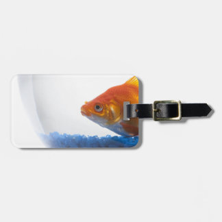 Goldfish in bowl on white background luggage tag