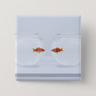 Goldfish in separate fishbowls looking face to fac 15 cm square badge