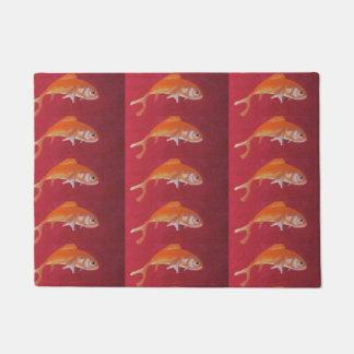 goldfish on red doormat