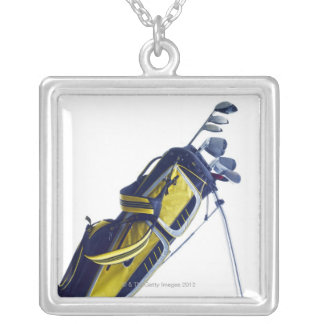Golf bag with clubs on white background silver plated necklace