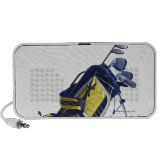 Golf bag with clubs on white background speakers