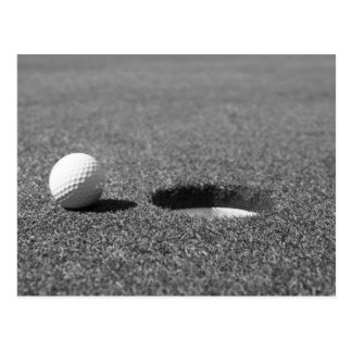 Golf Ball beside hole Post Cards