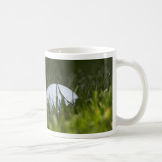 golf ball hiding coffee mug