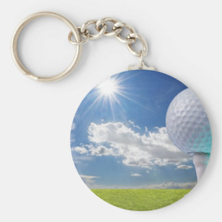 golf ball on a tee with grass basic round button key ring