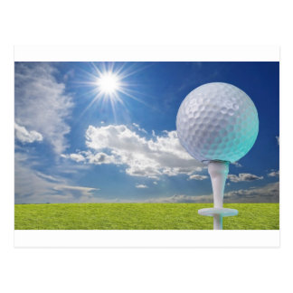 golf ball on a tee with grass postcard