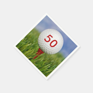 golf ball on red tee paper napkin